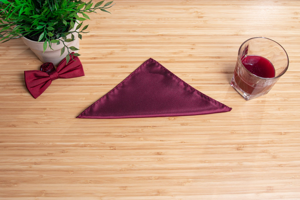 A square becomes a triangular fold on a table