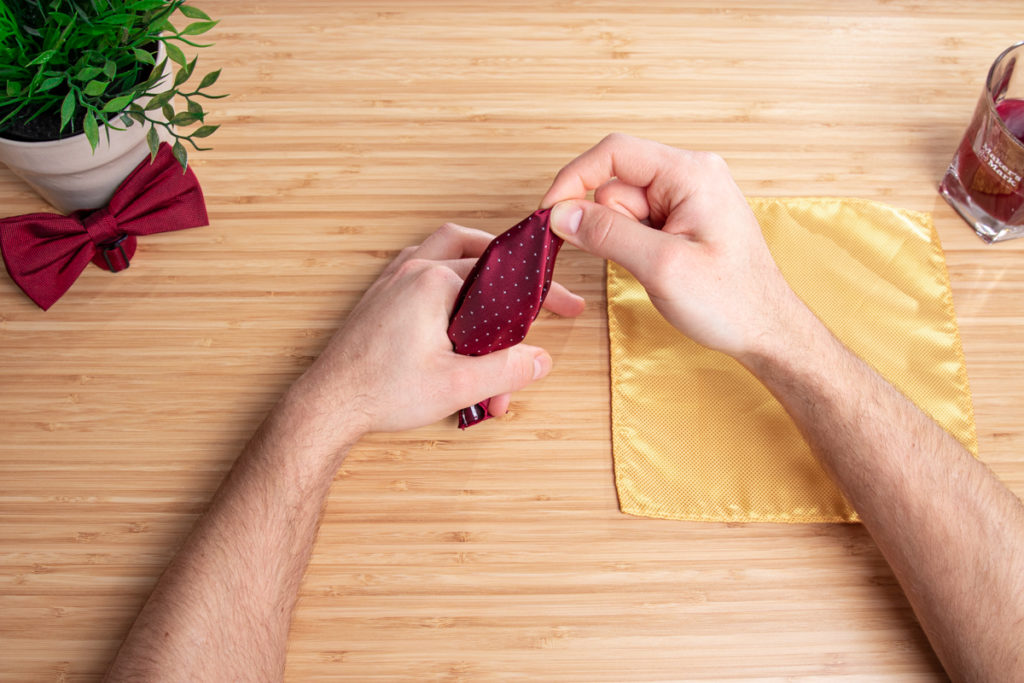 A handkerchief is folded according to the instructions for double puff folding.