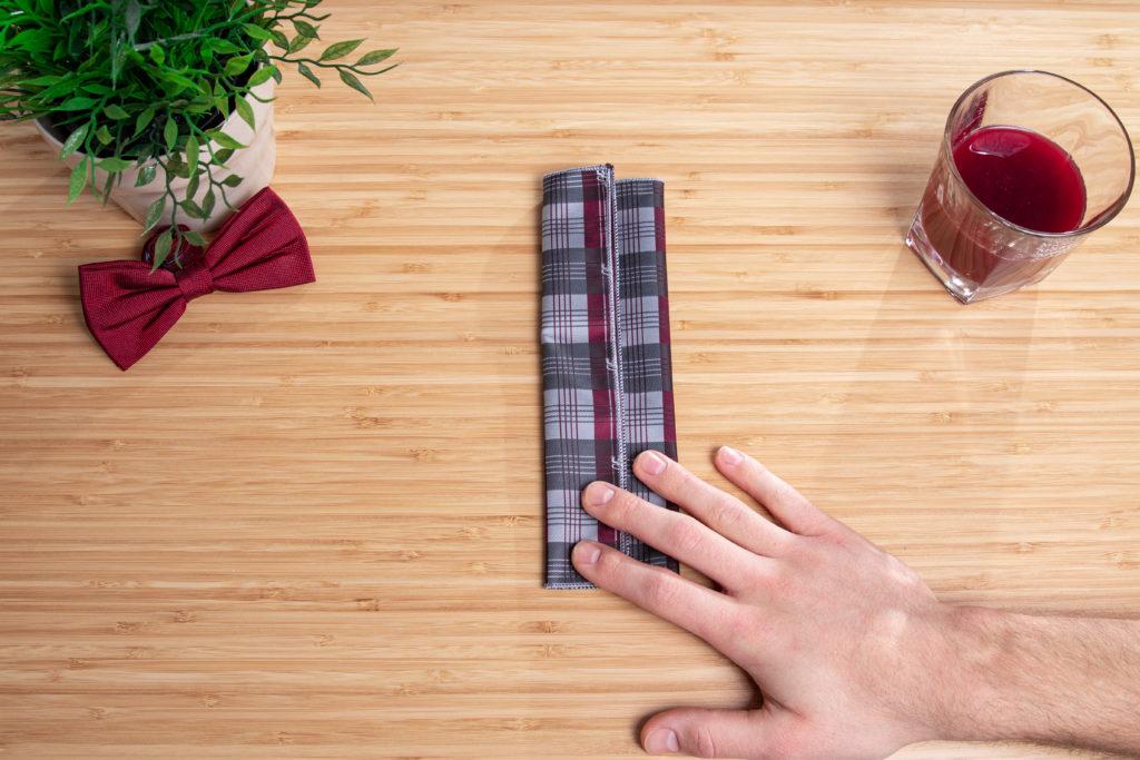 third step to fold a pocket square